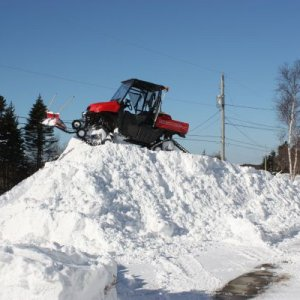 Big Red plowing snow